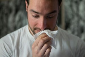 Person is sick from a common cold